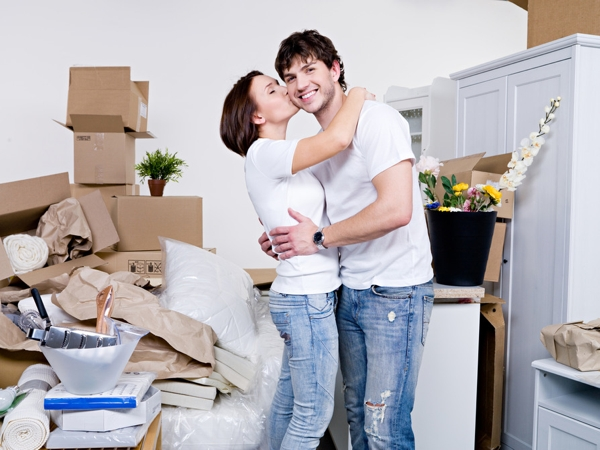 couple unpacking in condo